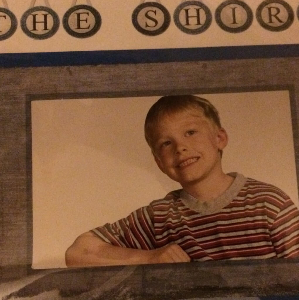 Picture of a little boy wearing a grey striped tshirt with text overlay - the shirt