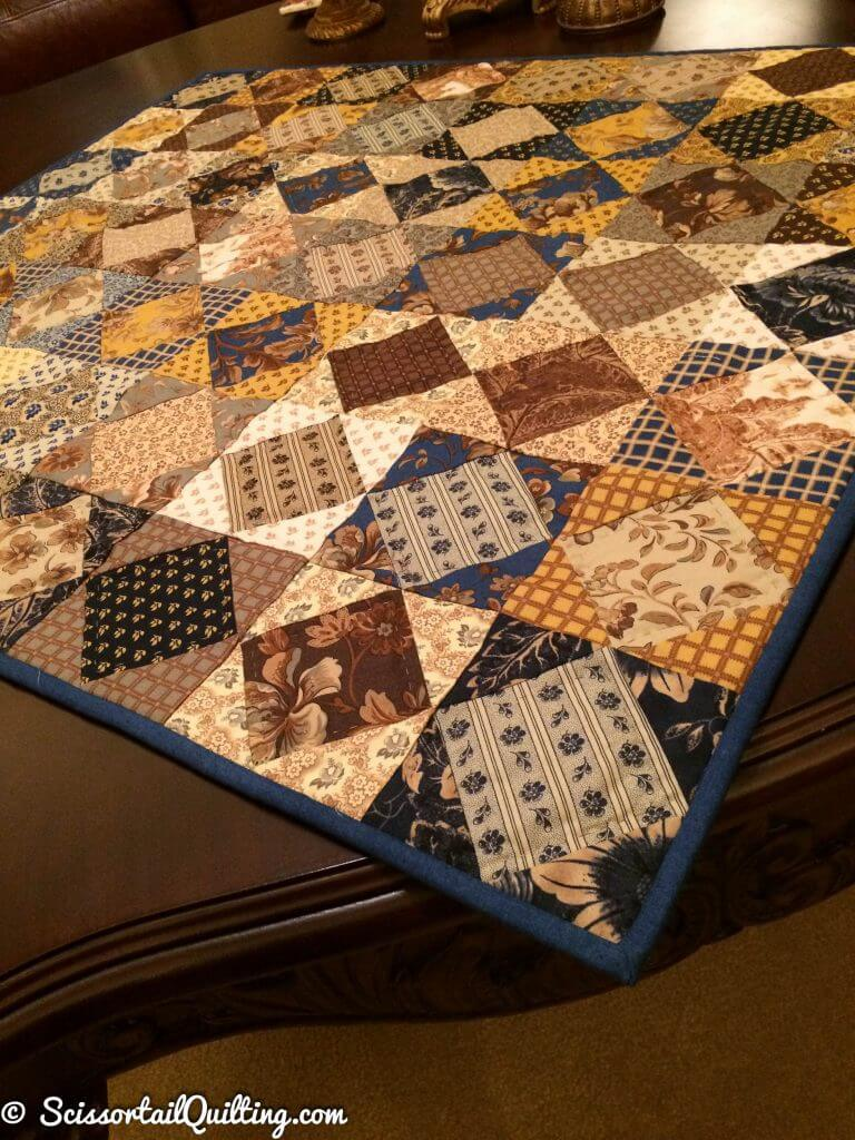 traditional indigo and cheddar colored quilt with square in a square blocks