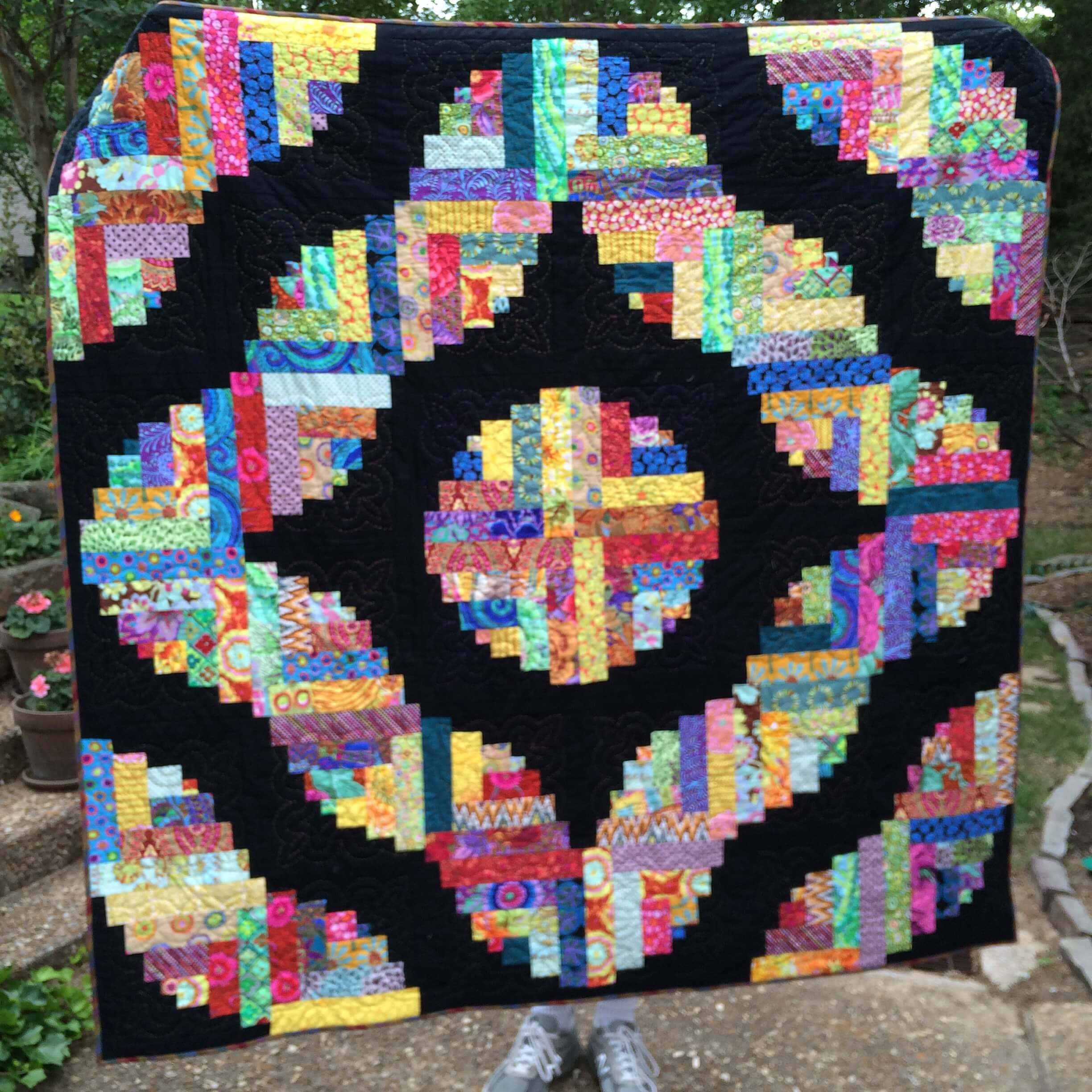Photo of Curvy Log Cabin Quilt - Hand Quilted