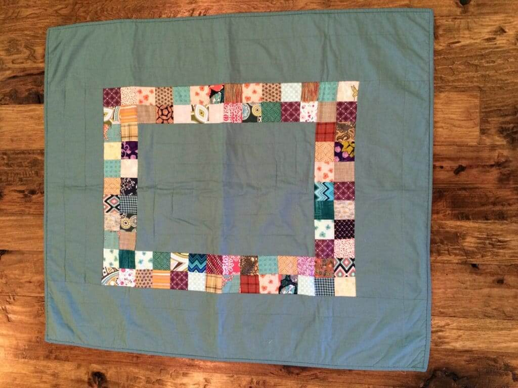 simple quilt made with small squares