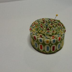 Coiled quilt binding roll