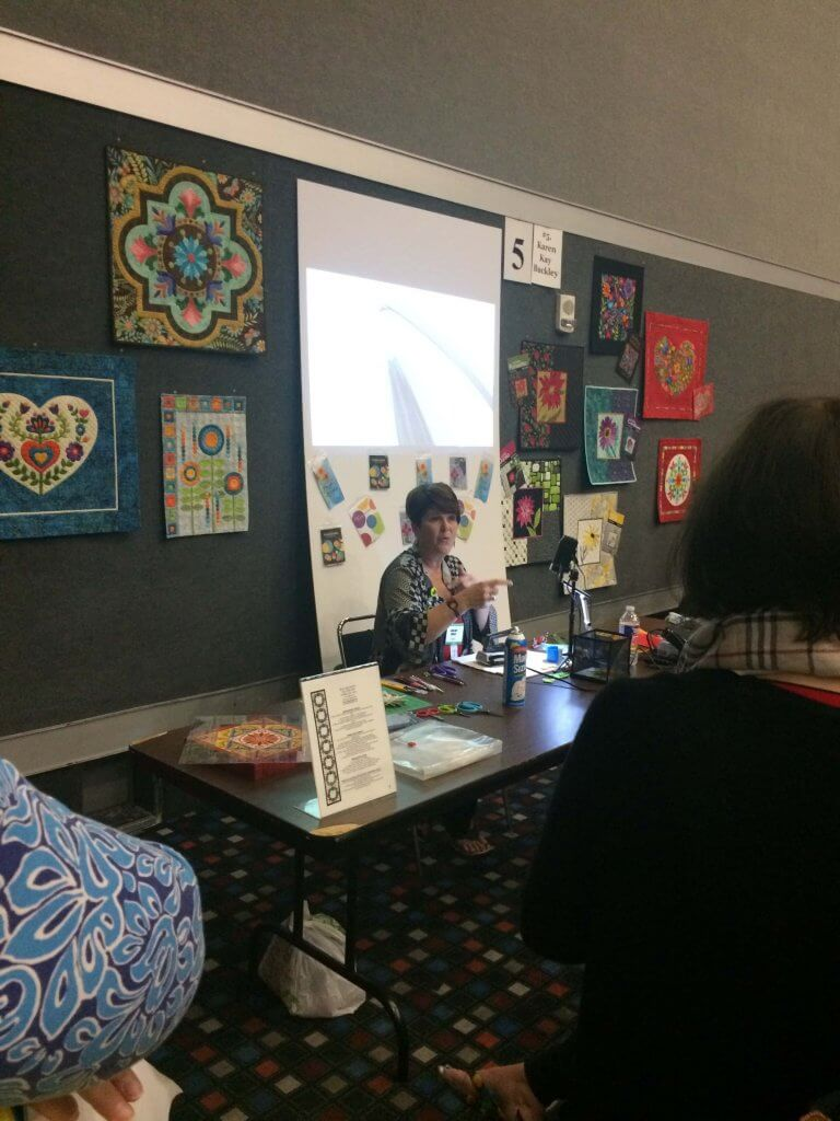 Karen K Buckley teaches how to make perfect applique points at the 2017 Houston International Quilt Festival