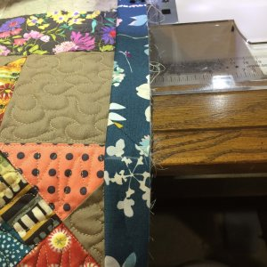 "Make sure the joined binding tails ""fit"" correctly on your quilt when you attach binding"