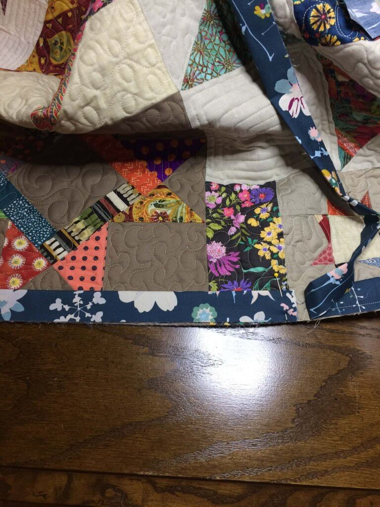 "Position the quilt with the buik away from you and the two loose ""tails"" closest to you when you attach binding"
