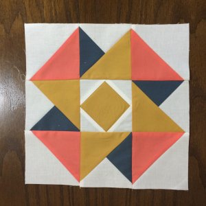 Photo of Completed Air Castle Quilt Block in peach, gold and navy