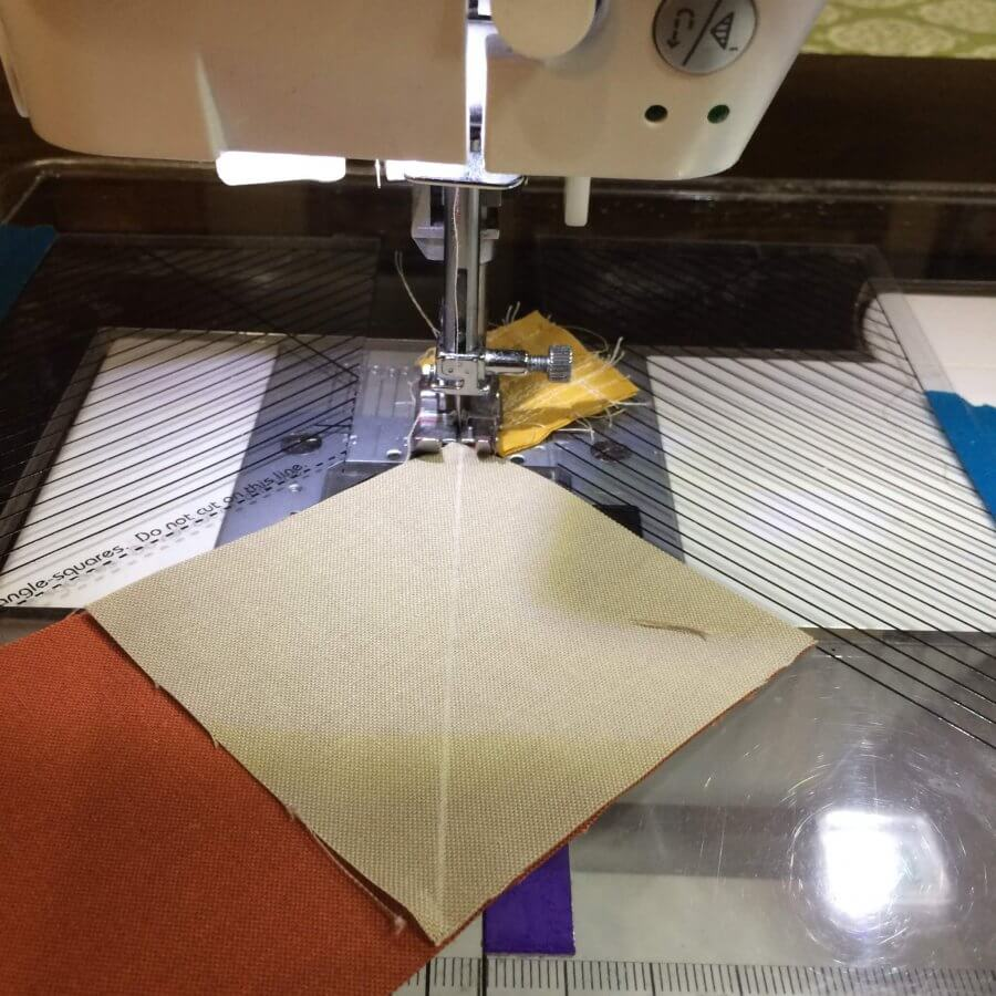 Image showing how to sew to right of center line when making flying geese.