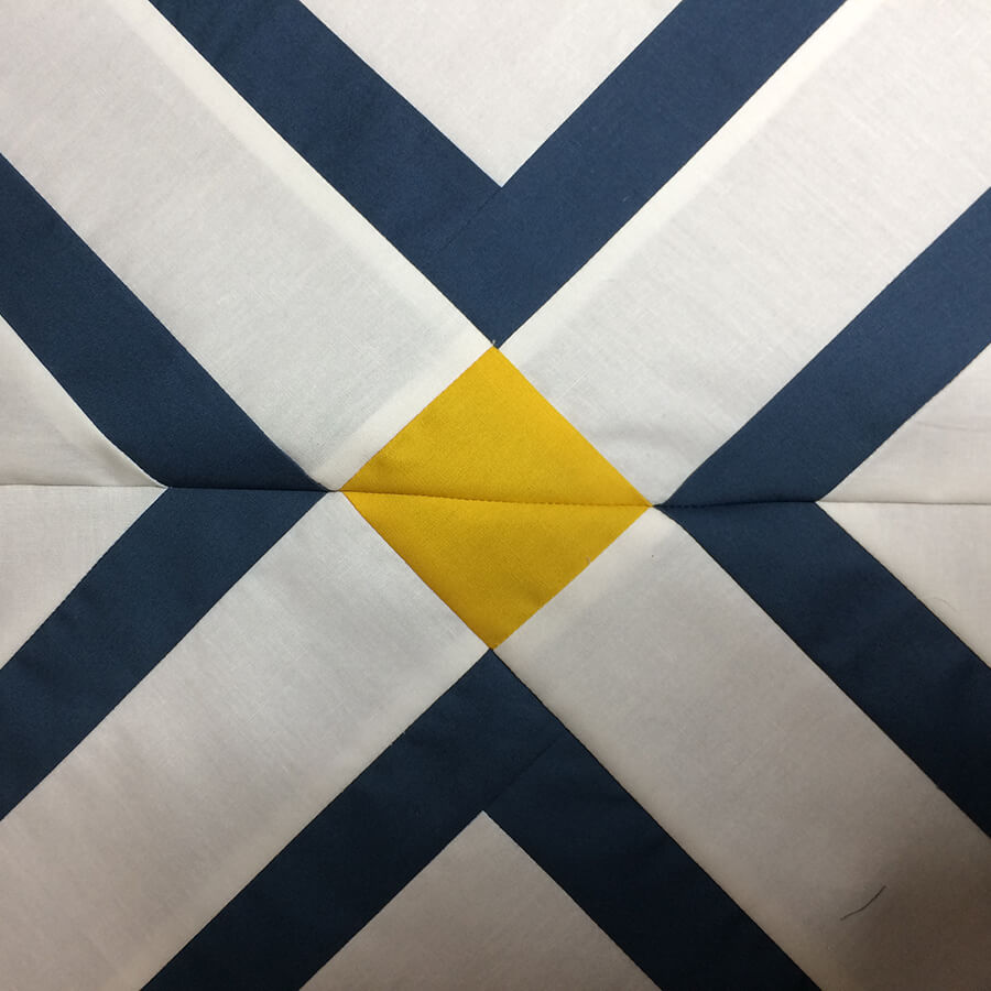 Photo showing Matching seams on two Mingle Quilt Blocks