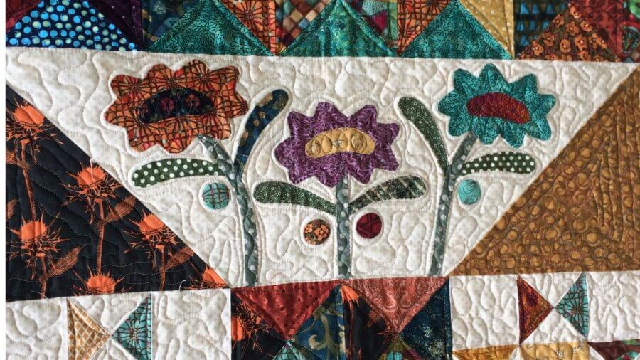 Applique on Late Bloomer Quilt designed by Kim Diehl's