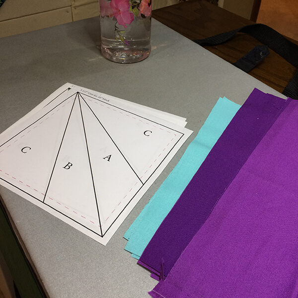 Photo of paper templates and fabrics ready. Let's learn how to paper-piece a quilt block