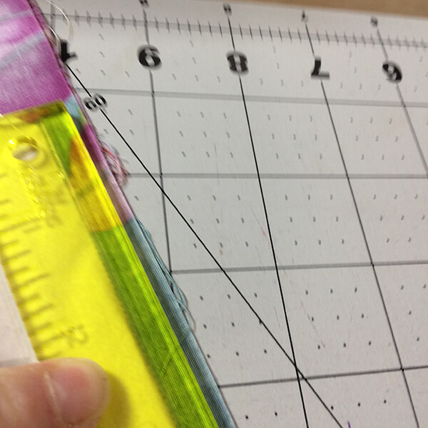 Photo showing use of ruler to trim excess seams