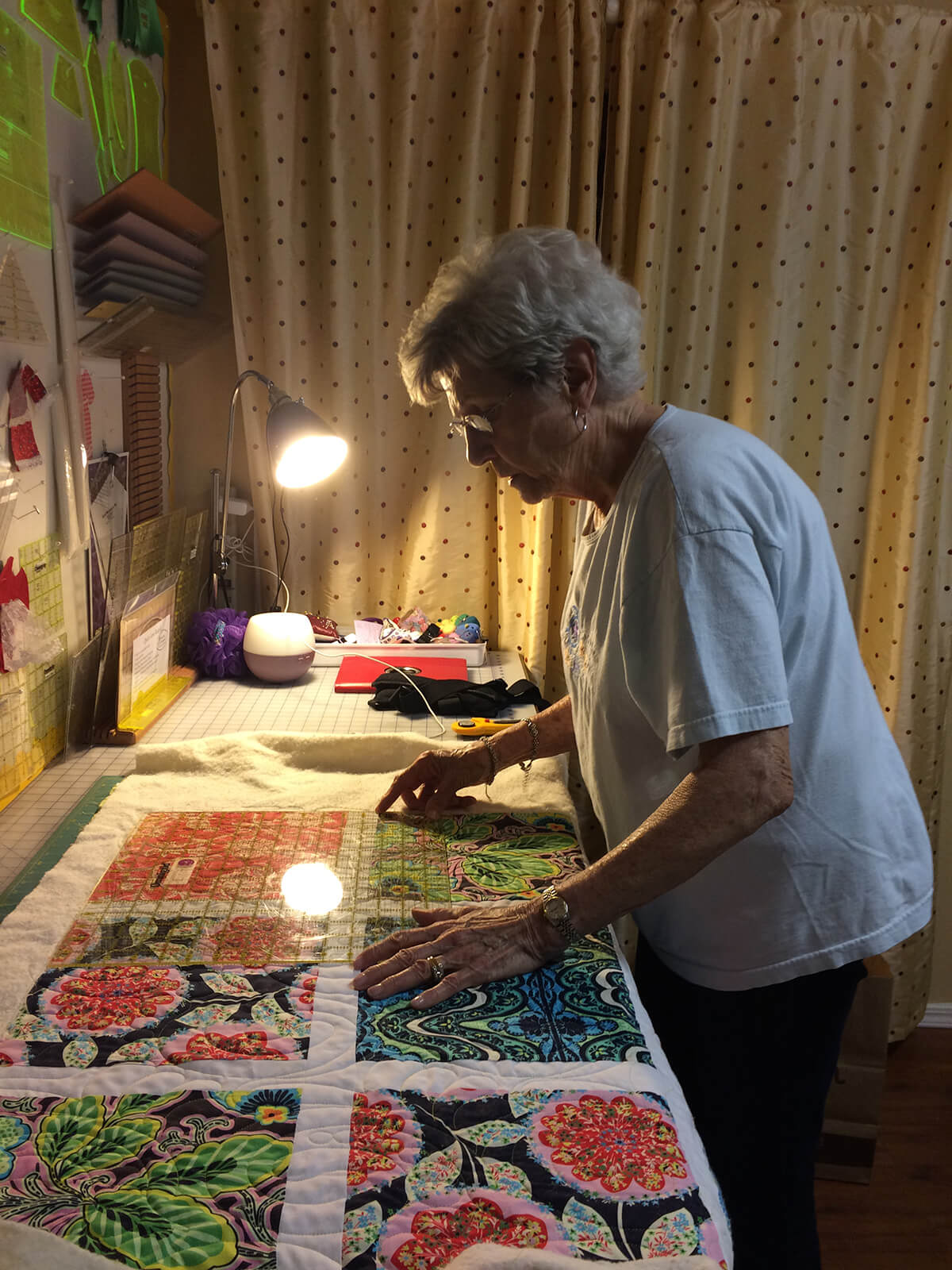 Woman trimming a quilt