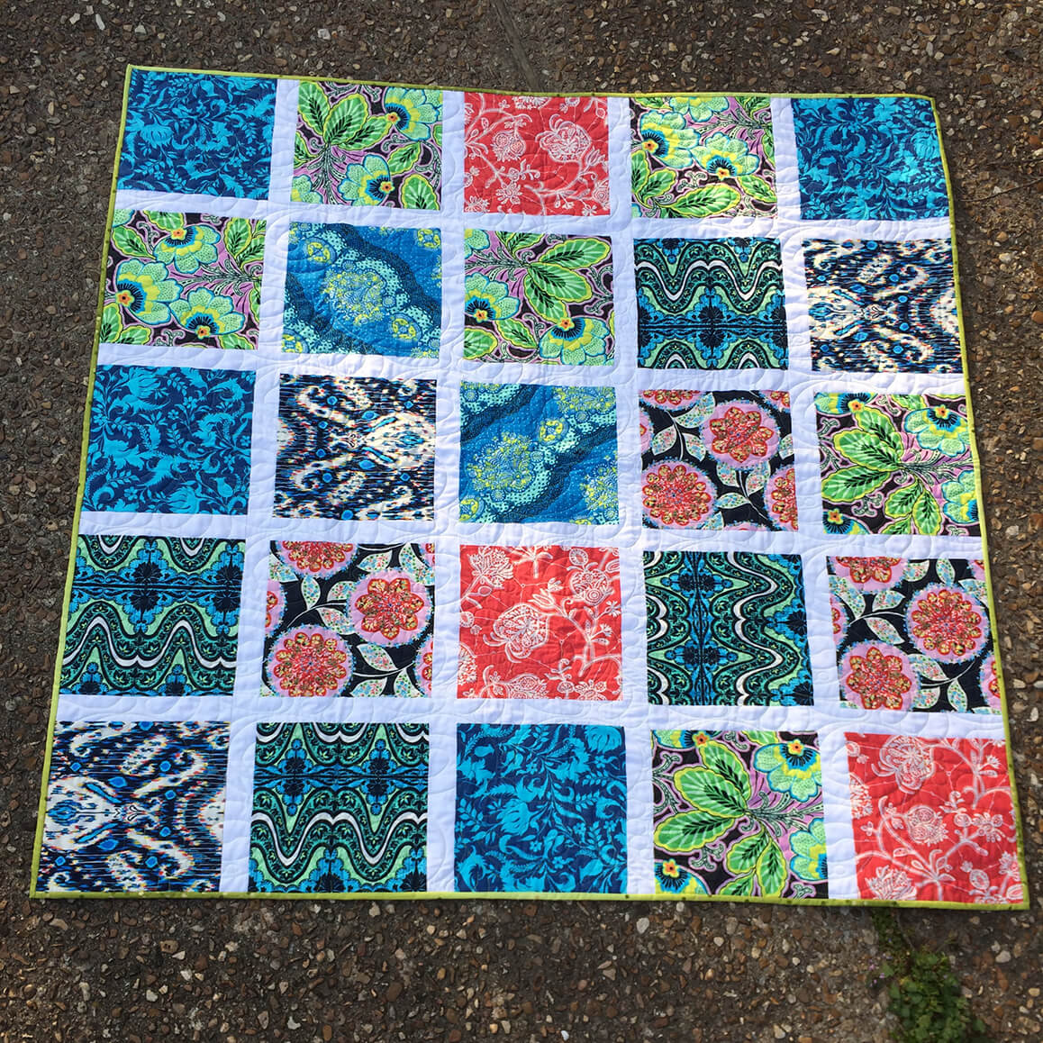 Completed quilt using Amy Butler fabrics