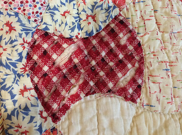 Photo showing Damaged patch on Vintage 30s Apple Core Quilt