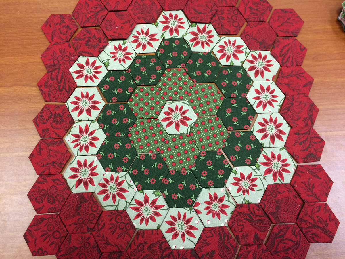 Photo of Hexies arranged for a Christmas pillow project
