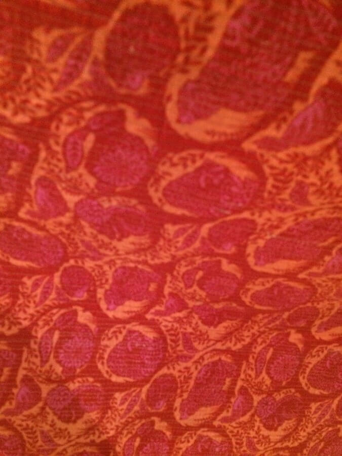 Red orange and pink fabric with forest animals