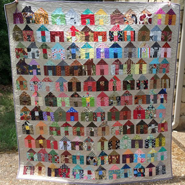 Photo of Carrie Nelson's Quilt Pattern with lots of scrappy house blocks