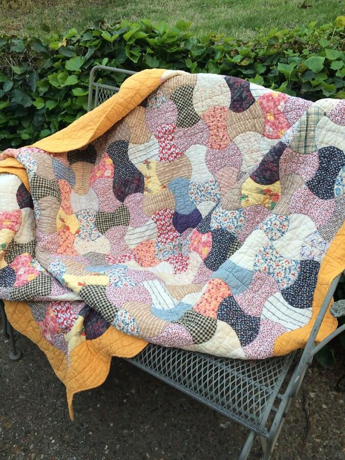 Photo of an 1930's Feedsack Quilt repaired by Scissortail Quilting