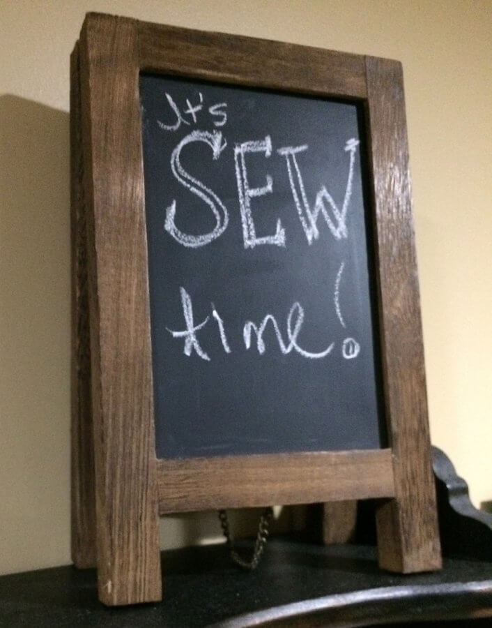 "Photo of mini chalkboard with the words ""It's Sew Time!"" written on it."