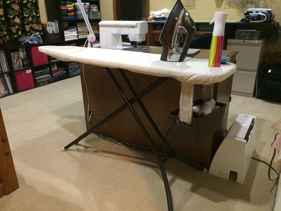 Photo of ironing board set up in sewing room