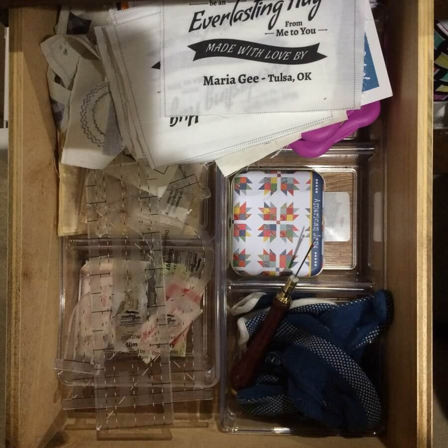 Photo of a drawer containing sewing notions