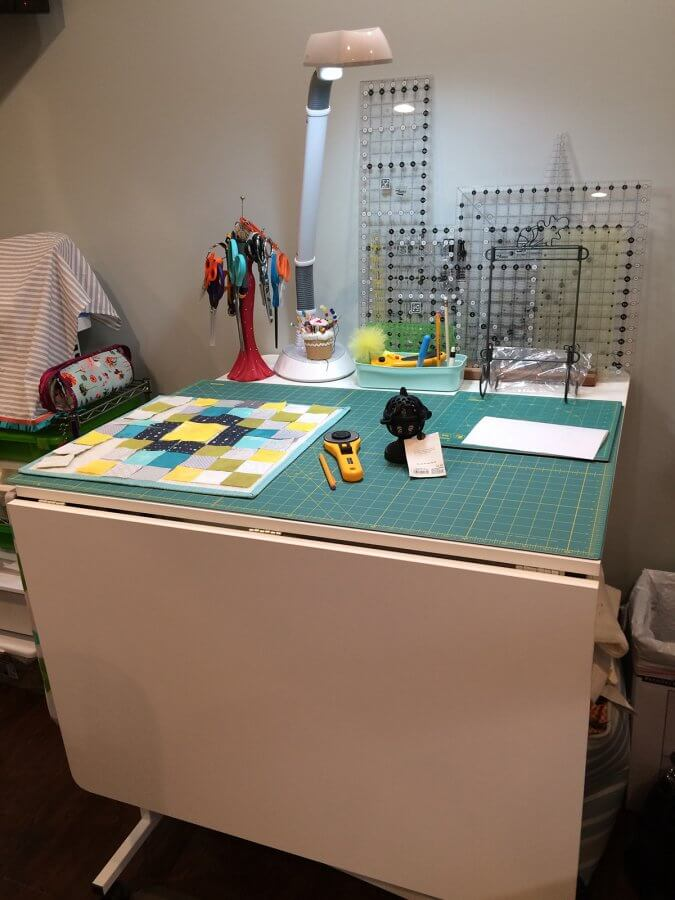 Photo of cutting table in sewing room