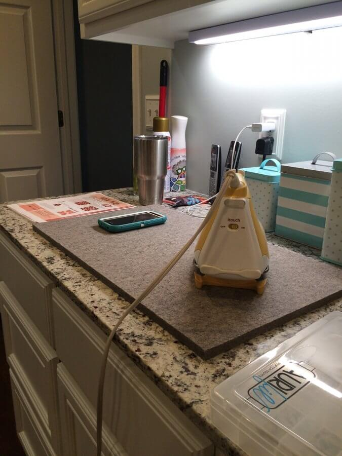 Photo of wool pressing mat and iron sitting on counter