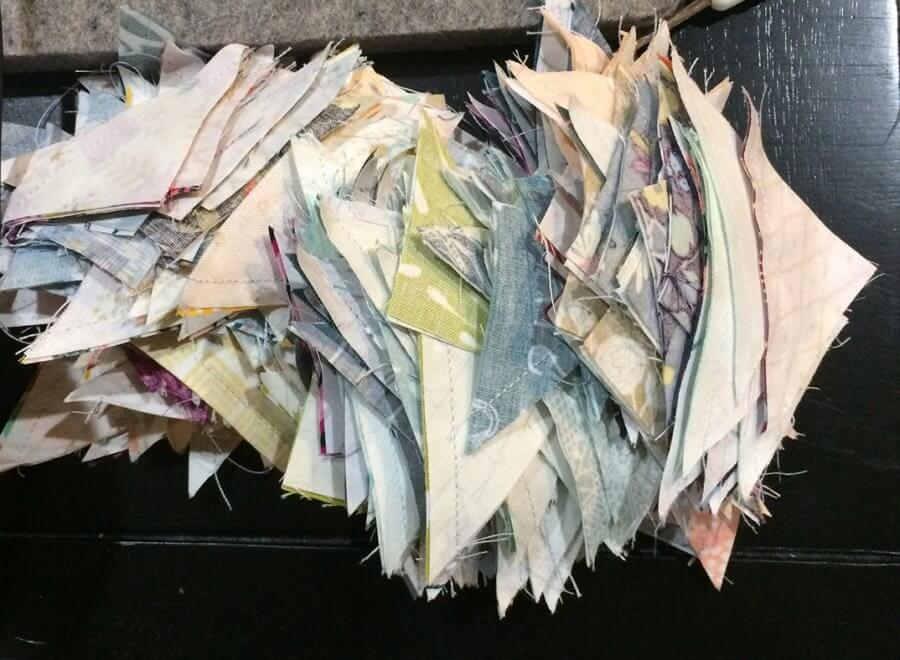 Photo of a pile of HSTs sewn from leftover Quick Corners