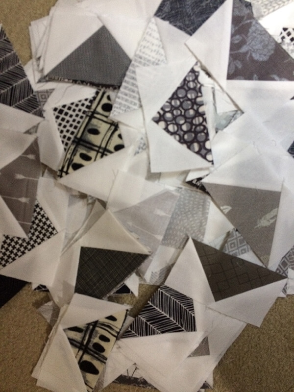 Photo of many black and gray Flying Geese Quilt block unites