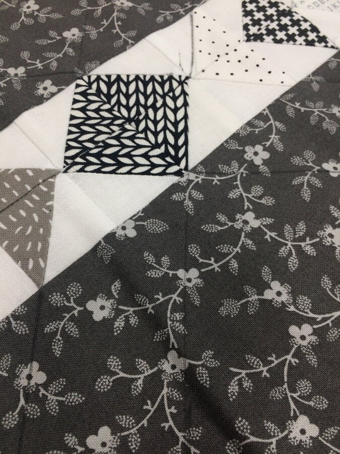Photo showing placement of plumb lines for quilting on tiny geese placemats