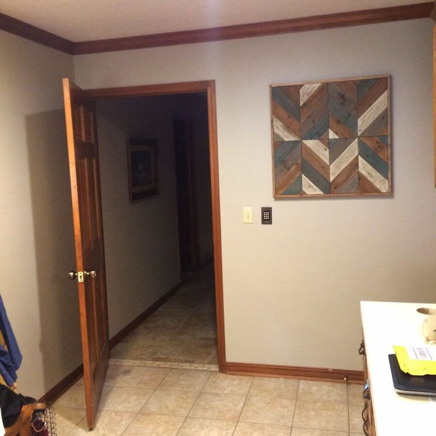Photo of a barn quilt hanging inside a home