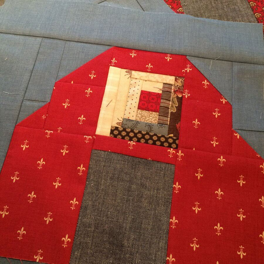 photo of log cabin patchwork set in a barn quilt block