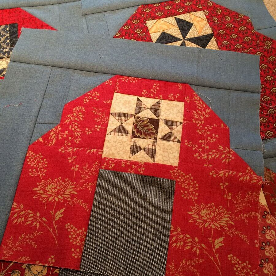 Photo of ohio star patchwork set in a barn quilt block