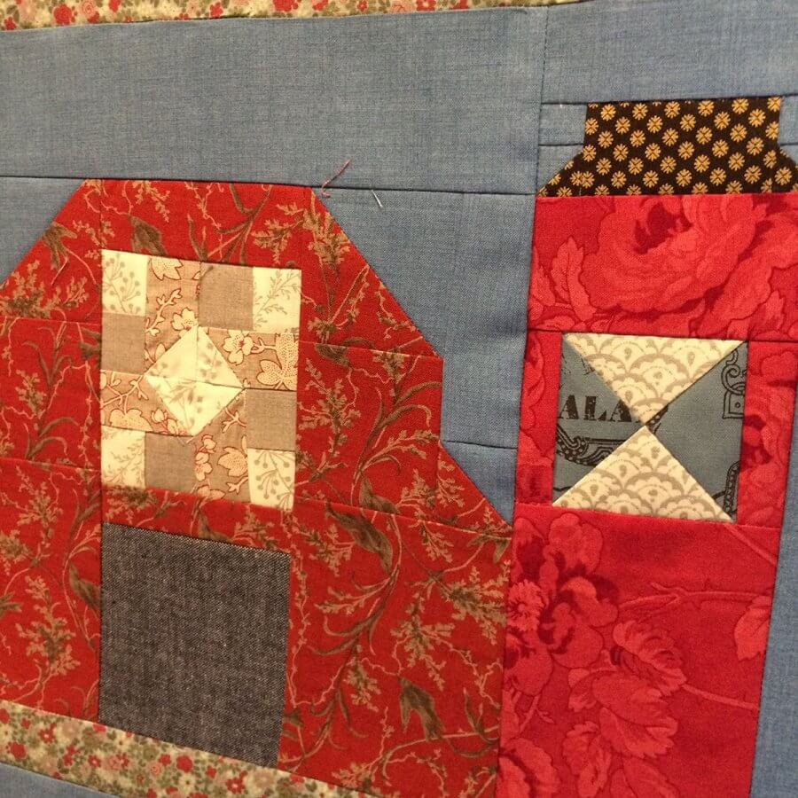photo of the oh Susannah patchwork set in a barn quilt block alongside a patchwork silo quilt block