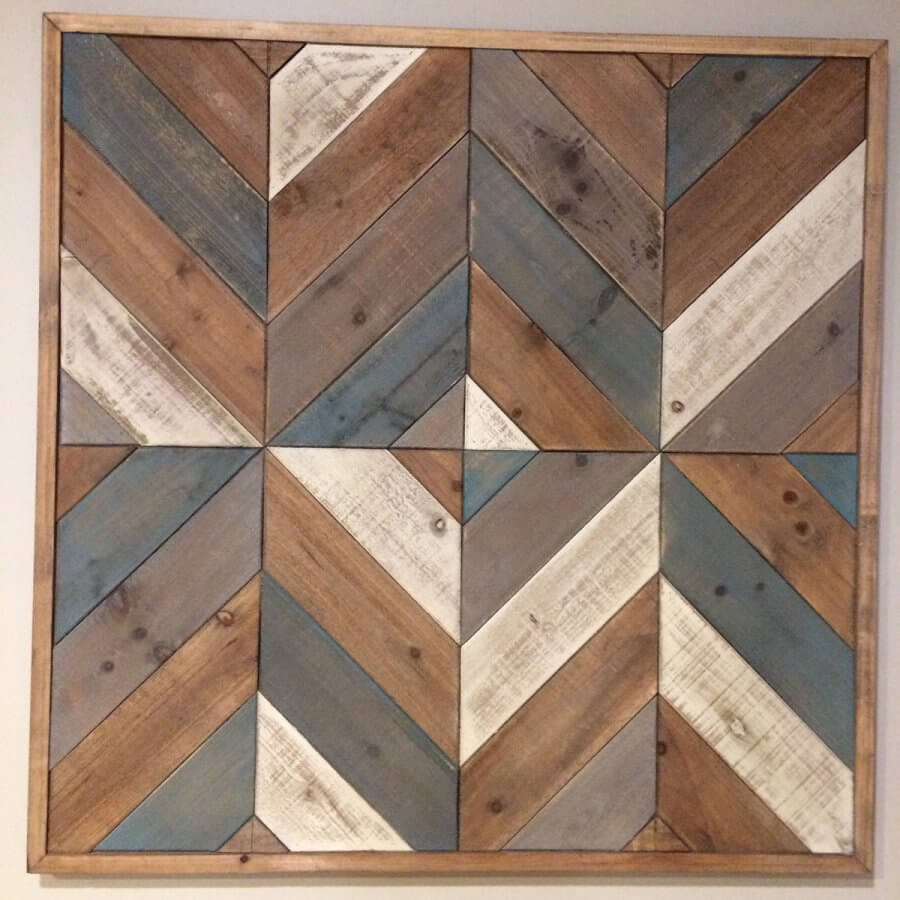 photograph of a large wooden stained barn quilt