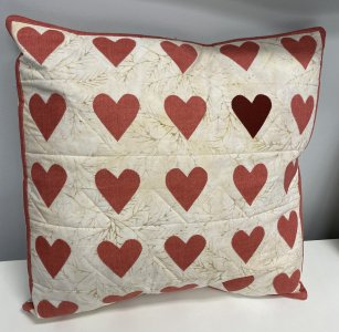 Pillow with appliqued hearts