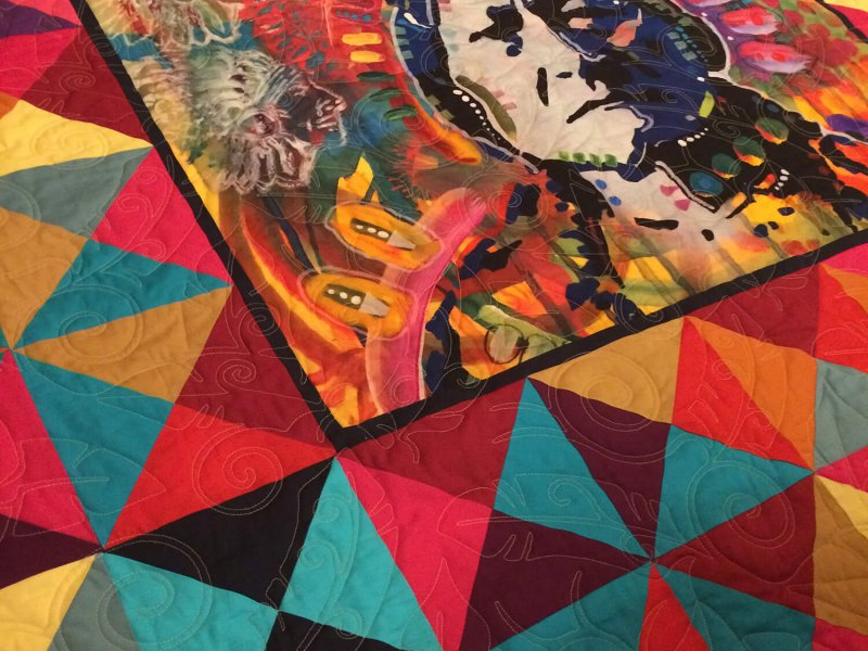 Colorful quilt with center panel featuring Sitting Bull