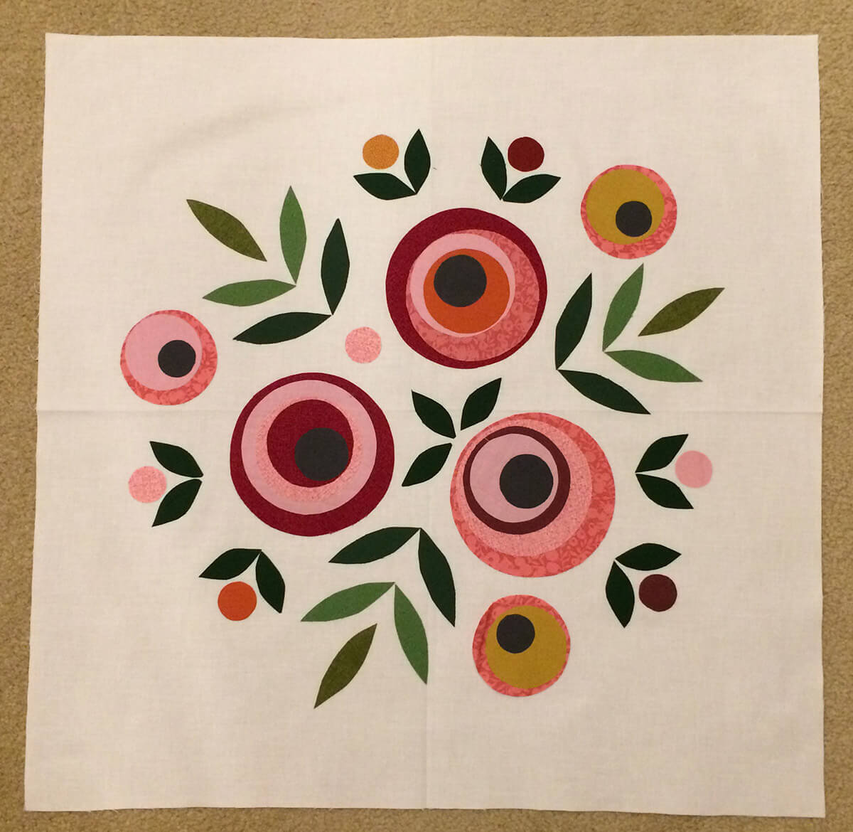 Photo of pillow top with appliqué flowers