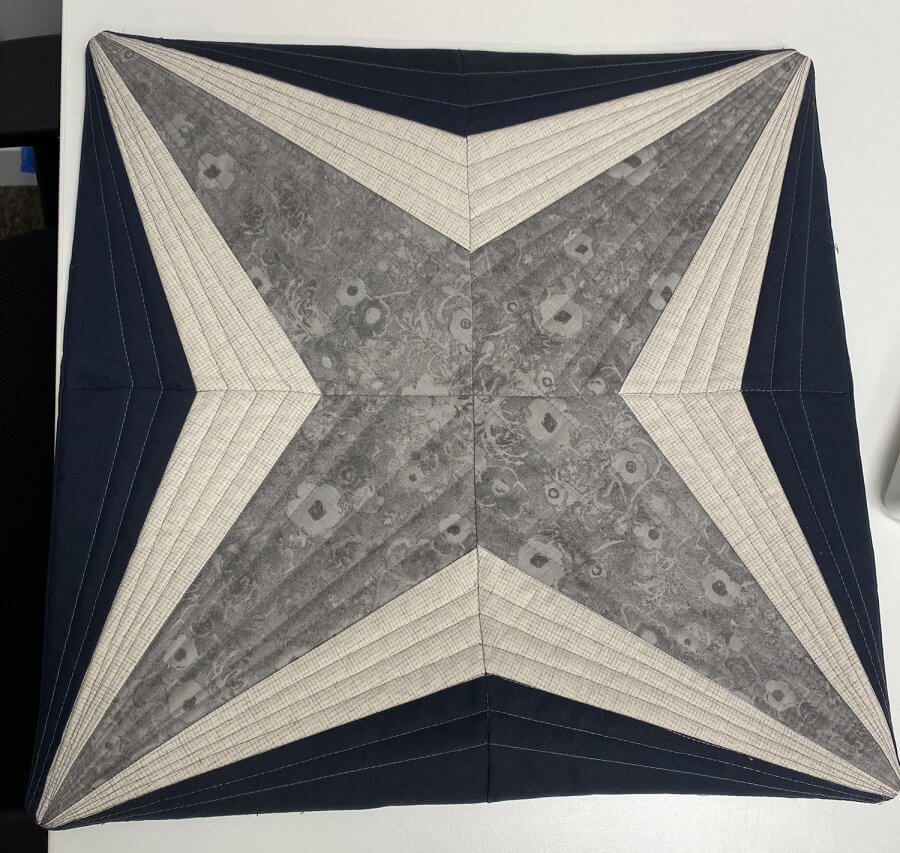 Pillow cover with grey star pattern